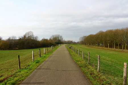 Hiking path on a dike in Wesel Stockfoto - 117302248