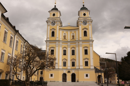 View of the basilica St. Michael in the center of the city Mondsee in Austria Stock Photo