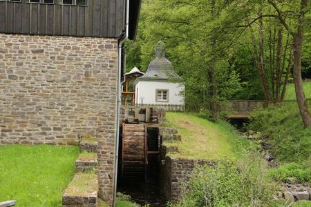 Historic building with waterwheel in Sauerland