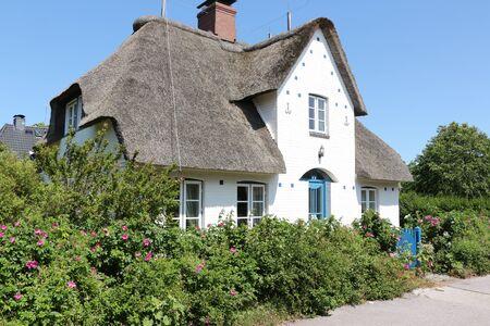 Historic Frisian house in the Friesendorf fog on the North Sea island Amrum