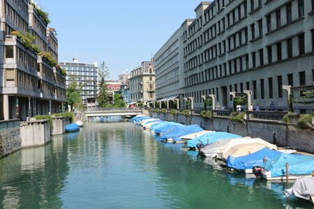 Historic buildings and sports boats in the center of Zurich Stok Fotoğraf