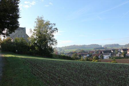 View of Schwandegg Castle and the town of Waltalingen in the canton of Zurich in Switzerland