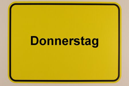The lettering Thursday on a city entrance sign Фото со стока