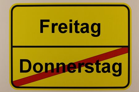 Graphical representation of the weekdays Friday and Thursday on a town sign Standard-Bild