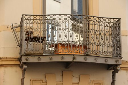 Old balcony at a historic building in the center of Ettelbruck in Luxembourg Фото со стока