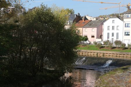 Watercourse and residential building in the center of Ettelbr?ck in Luxembourg Фото со стока