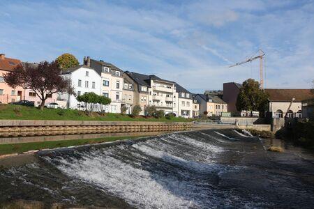 Rapids on a river in the center of Ettelbr?ck in Lusxemburg Фото со стока