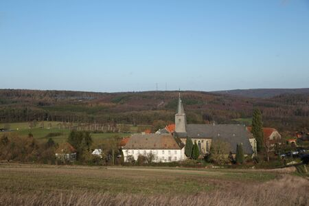View of Oelinghausen Monastery nestled in the gentle hills of the Sauerland