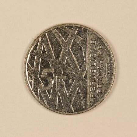 Front of a former French 5 franc coin Banco de Imagens