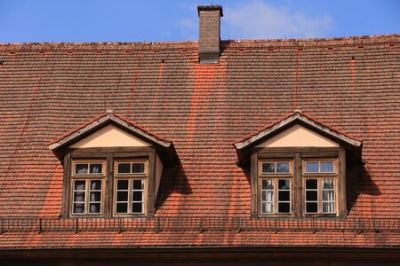 Historic roof with dormer windows on a building of Bronnbach Abbey in southern Germany