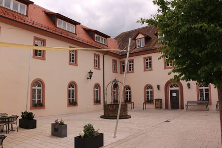 View of the inner courtyard of a former monastery in the center of Tauberbischofsheim