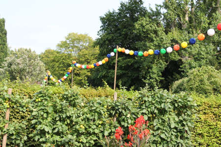 Colorful lanterns on a summer day in the Westfalenpark in Dortmund