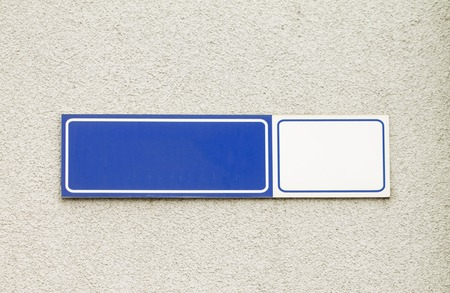 nameplate: Blue modern styled house nameplate empty white space for number and text with street name on the concrete wall background.