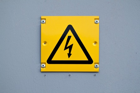 be careful: European yellow lightning sign of high voltage. Warning about dangerous electricity.