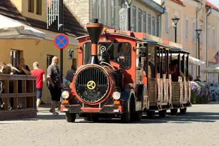 romney: HAAPSALU, ESTONIA - JULY 16, 2016. Old retro working locomotive train with people inside. American Beauty Car Show 2016.