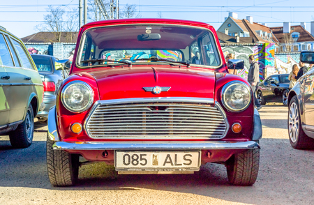 TALLINN, ESTONIA - MARCH 6, 2017: Red beautiful Mini Cooper Standing at Car Moto Show Exhibition in Tallinn, Estonia with summer sunny weather