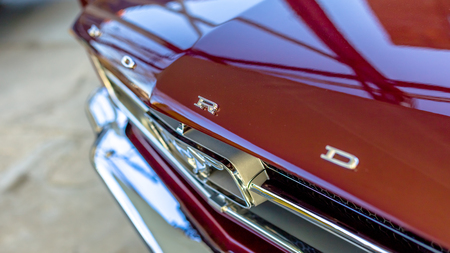 TALLINN, ESTONIA - MARCH 6, 2017: Dark red close up Ford Mustang Retro Vintage Standing at Car Moto Show Exhibition in Tallinn, Estonia with summer sunny weather