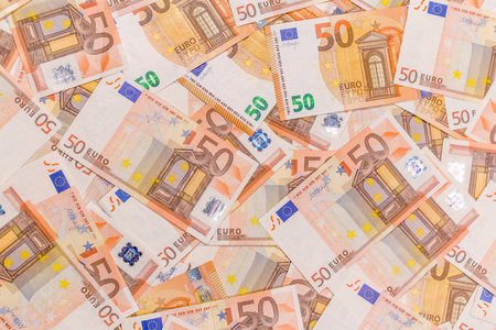 Pile of 50 euro as background. Euro currency banknotes stack. Money bank finance business.