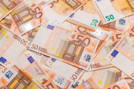 Pile of 50 euro as background closeup macro. Euro currency banknotes stack. Money bank finance business. Banco de Imagens