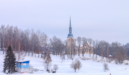 Otepaa St Mary s Lutheran Church at Winter. Snow castle in Estonia mountains. Blue beautiful background of Estonia frozen holiday ice. Banco de Imagens
