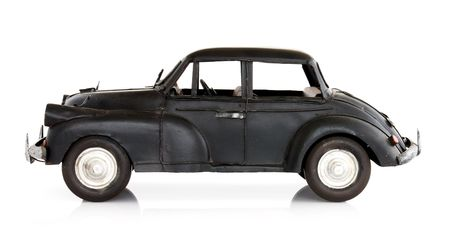 british culture: Classic English style toy car, isolated on white. Side view.