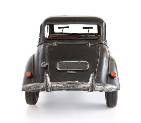 Classic English style toy car, isolated on white. Back view. Archivio Fotografico