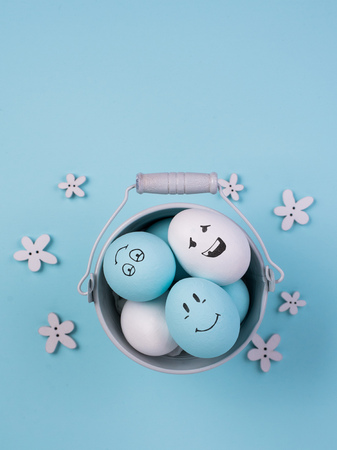 Painted Eggs with cute hand drawn funny faces. Happy easter card concept. 写真素材