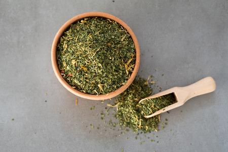 Yerba Mate tea on neutral stone gray backgrund. Healthy, energy boosting drink on neutral stone gray backgrund.