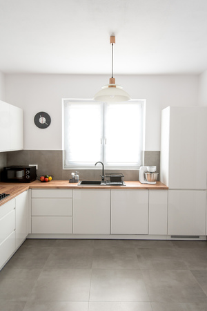 Neat Modern white kitchen with varnished mdf boards, with accessories. Modern livfestyle & cooking concept.