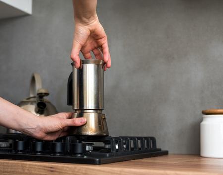 Preparing a traditional italian style coffee with coffee percolator.