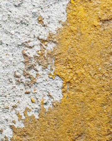 Cement and Concrete texture for pattern and background. Grungy wall background with cracks, stones and paint.