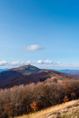Autumn in the Bieszczady Mountains Poland. Trekking trail, blue sky. Zdjęcie Seryjne