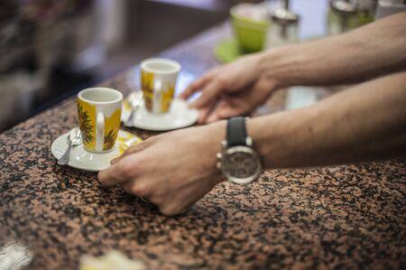 barman serving two original italian coffee