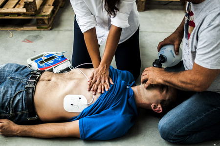 assistance to the unconscious man with CPR Stock Photo