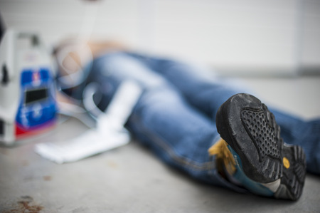defibrillator: unconscious man after cardiac arrest with defibrillator