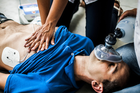 infarct: girl practicing CPR and CPR Stock Photo