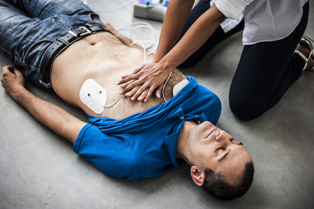 infarct: girl performs CPR on the unconscious boy as a result of heart attack