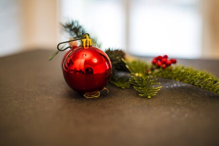 Christmas decorations with branch, balls and red berries Archivio Fotografico
