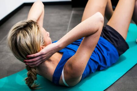 abdominals: girl making fitness exercises, stretching, weight lifting and abdominals