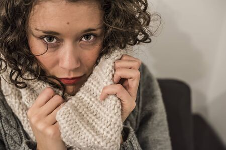 woman with a hot scarf in wool in a gelid winter Archivio Fotografico