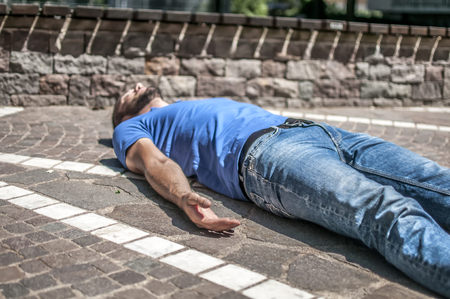 respiration: Unconscious guy after heart attack in the outdoor Stock Photo