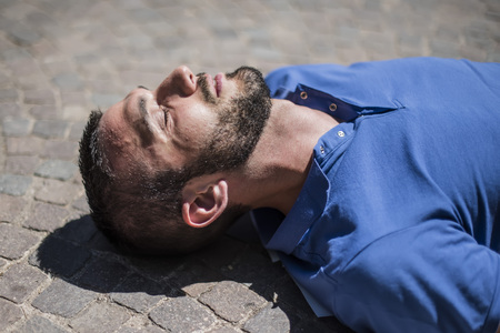 Unconscious guy after heart attack in the outdoor Stock Photo