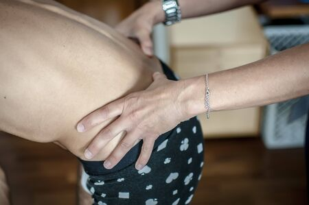 orthopedic physiotherapist cures a young athlete bad backache