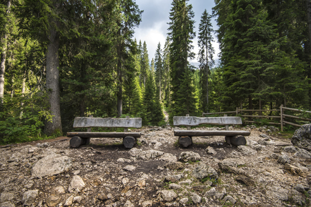 two benches in the mountain landscape of northern italy