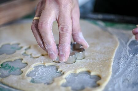 Woman kneads and prepares homemade cake and biscuits Stok Fotoğraf