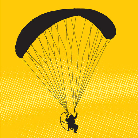 skydiving: Silhouette of a paraglider at sunset