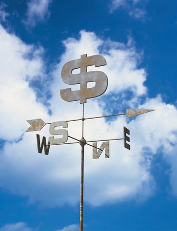 bussiness: Financial weather vane and blue sky.