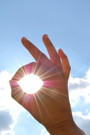 finished good: A OK sign through sun rays Stock Photo