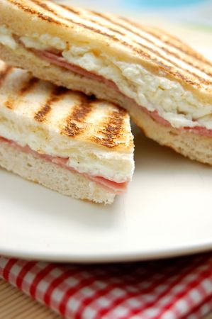 toasted: Grilled sandwich with melted feta cheese and ham