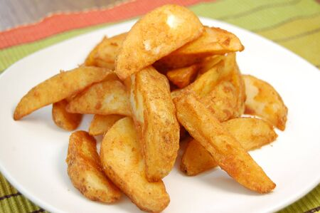 seasoned: Plateful of seasoned potato wedges
